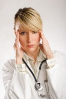 young beautiful woman doctor in stress portrait